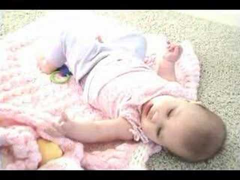 teaching a baby to roll over