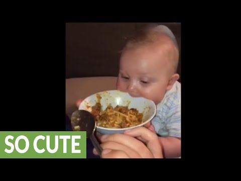 Hungry baby super excited for spaghetti dinner