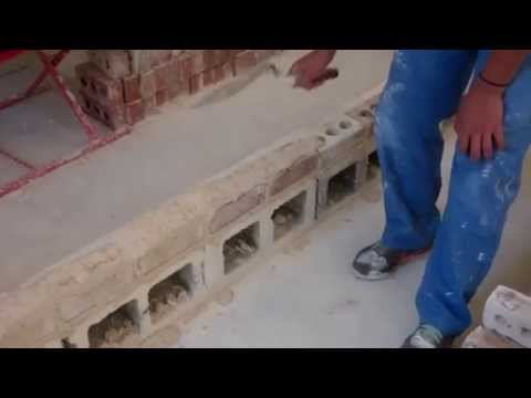 High School Student Showing How to Lay bricks on speed line