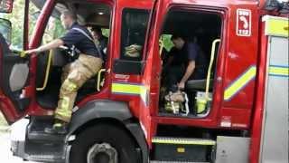 firemen getting dressed fast