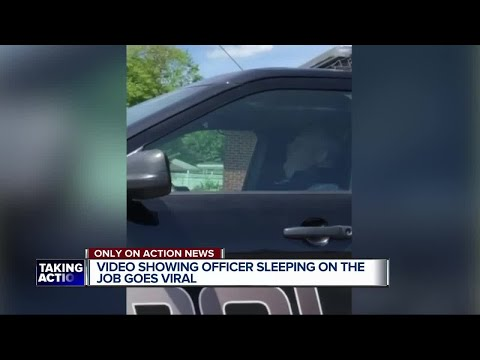 Dearborn Heights police officer caught on video sleeping in his cruiser