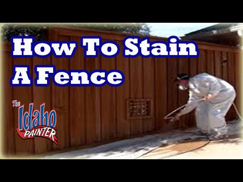 How to stain a fence.  Spraying a fence with an airless paint sprayer.