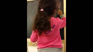 Nasreen writing her name in English