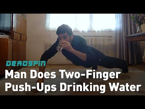 Man Does Two-Fingered Push-Ups While Drinking Water