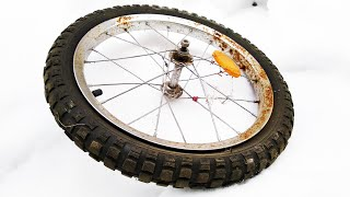 Cool idea of an old Bicycle wheel!