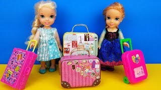 Vacation packing ! Elsa and Anna toddlers - shopping for luggage - suitcases - Barbie is the seller