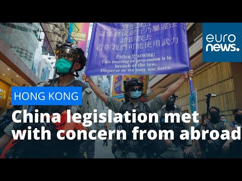 Hong Kong democracy: China legislation met with concern from abroad, defiance at home