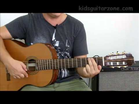 Guitar lesson 1B : Beginner -- How to hold a guitar and pick