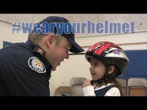 @TorontoPolice Bike Helmet Giveaway at St.Francis Xavier School | P.C. Peter De Quintal
