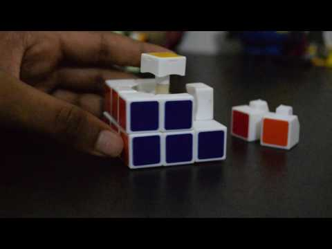 How to take apart and put together a 3x3 Rubik's Cube (Fast and Easy)