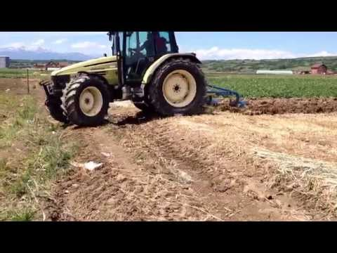 Plowing with tractor Hurlimann-910.6 and plough UNLU
