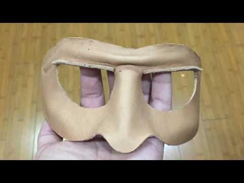 Making a leather Mardi Gras mask.