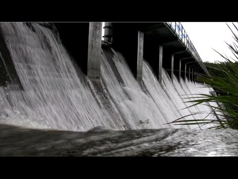 Manly Dam Spills Over During Storm Event