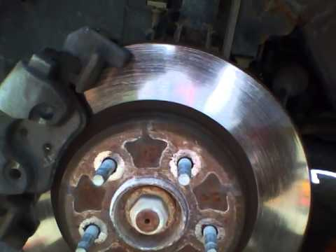 Ford Escape 2008 front brake change part 1
