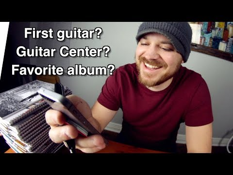 First guitar?... Guitar Center?... Most influential album?... (Q&A while signing)