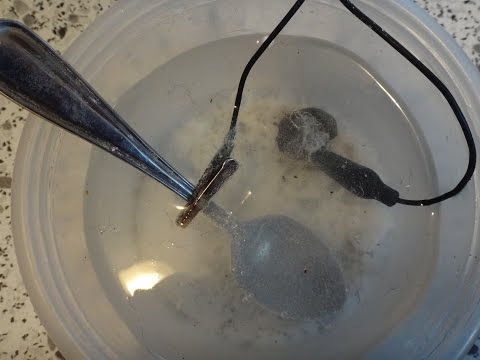 Last beach hunt of 2014 2 silver coins and electrolysis clean them up metal detecting Nova Scotia
