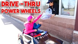 KIDS Driving Power Wheels Ride On Car to a DRIVE THRU