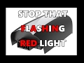 STOP THAT FLASHING RED LIGHT