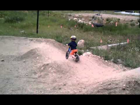 Two-Year old on Pump track with Strider