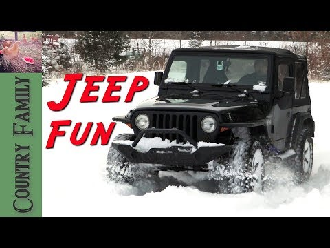 Country Family Playing In the Snow with the Jeep