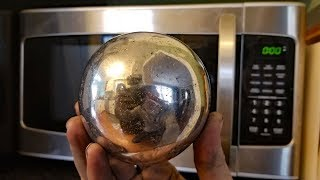 Making a Polished Aluminum Foil Ball in a Microwave. Microwaving aluminium.