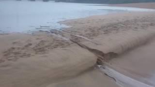 Black Rock River ( mahlongwa) river breaching into the Indian ocean