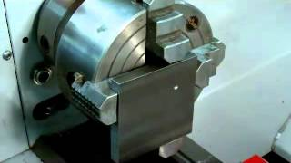 dialing work off center in a lathe using a 4-jaw chuck