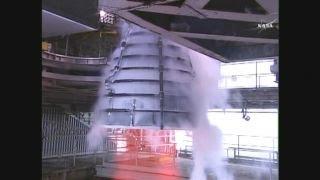 NASA test fires engine for world