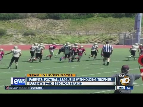 Parents say youth football league withholding trophies for players