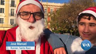 Thousands Dressed as Santa Race in Madrid Raising Money for Cancer Care