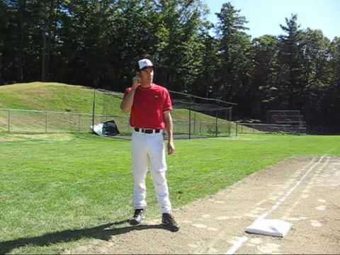 Third base coach giving signals
