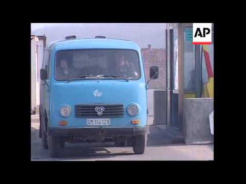 BOSNIA: BOSANSKA RACA: TRUCKS WAIT FOR CLEARANCE TO ENTER BOSNIA