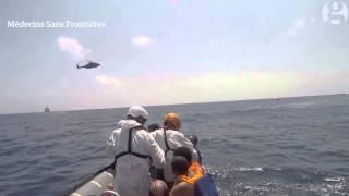 Mediterranean migrant crisis: search & rescue boat plucks migrants from sea