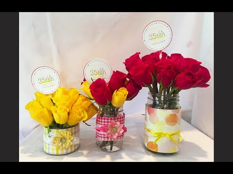 Learn how to make easy mason jar vases with scrap paper and ribbon