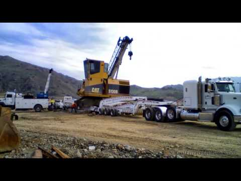 Process of moving a CAT 5130B excavator