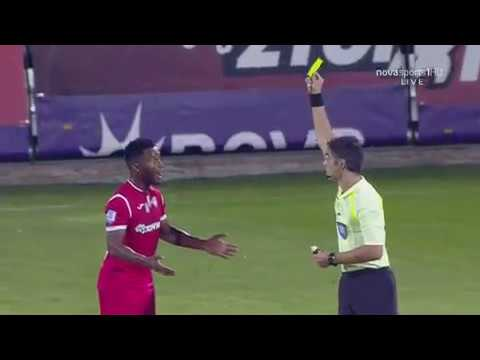 Xanthi player Brito gets yellow card for wiping vanishing spray on referee