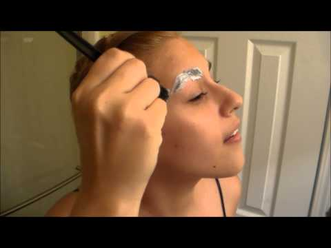 BLEACHING MY BLACK EYEBROWS BLONDE - warning I am crazy in this video