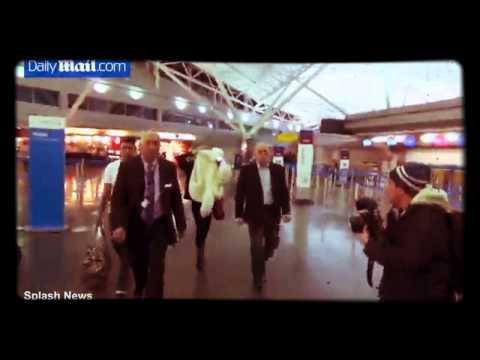 RAW VIDEO: MILEY CYRUS Arrives at JFK Her Hair a Bun Still Sporting Liam Hemsworth Ring