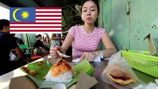 Japanese girl having Malaysian breakfast in Penang
