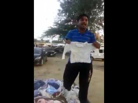 Funny Man Selling second hand baby clothes