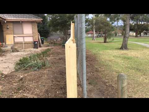 Treated pine paling fence with rake down. Nailed it Fencing
