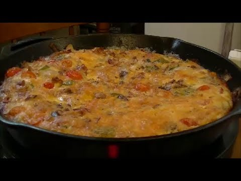 A Delicious Frittata using Bacon, Fried Potatoes, Tomatoes, Onions, Peppers, Eggs and Cheese