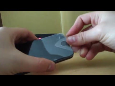 How to remove and install a tempered glass protector on iPhone 5