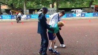 Mo Farah helping a child