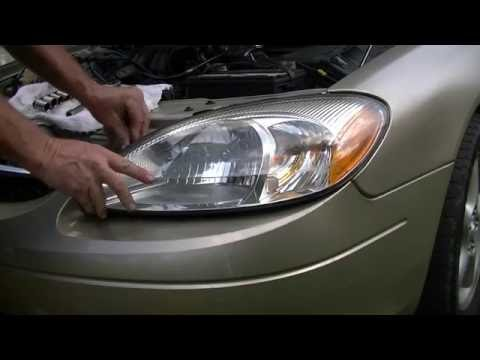 Changing a headlight in two minutes! -ford Taurus