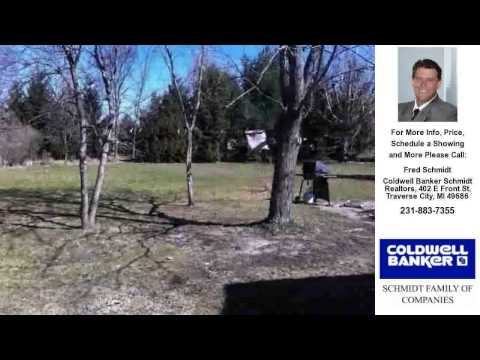 5734 OLD MAPLE TRL, Grawn, MI Presented by Fred Schmidt.
