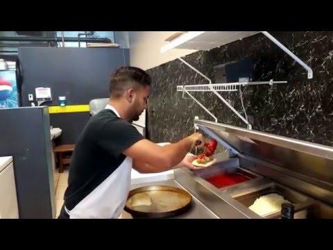 Making a Meatball Marinara Sandwich
