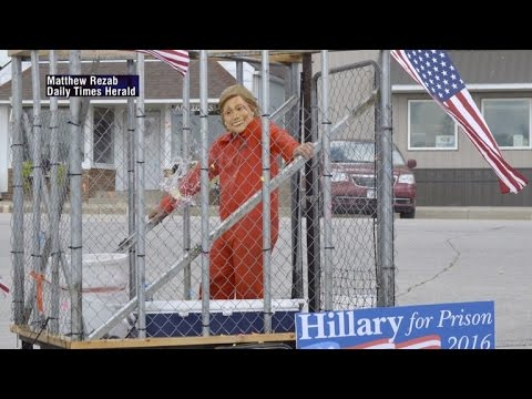 Controversy Looms Over Float With Hillary Clinton In Prison Jumpsuit Inside Cage