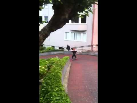 Patrick Switzer skateboards down Lombard St