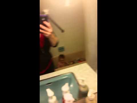 Cleaning Bathroom Mirror with Norwex Envirocloth and Polishing Cloth